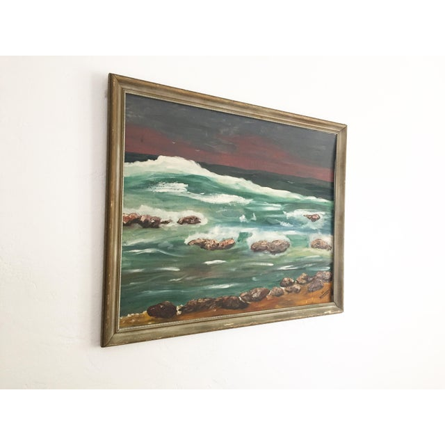 An original vintage oil painting of an oceanscape on canvas board in a wood frame. Lovely colors and brushstrokes. Signed...