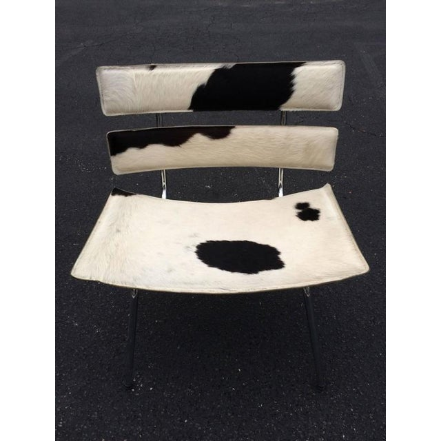 Cowhide and Chrome Eames Style Chair. Signed underside in leather kehl. Wide and comfortable seating guaranteed to give...
