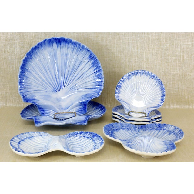 A vintage, ceramic set of dishes - 2 platters, 4 plates 3-part divided bowl, and 2-part divided bowl, with a seashell...