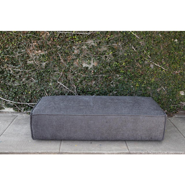 Large and comfy upholstered ottoman that would make a great coffee table with a few decorative trays place on it. Medium...