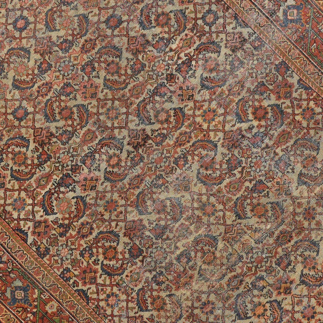 This distressed antique Mahal rug features a Modern Industrial style. The remarkably refined weave in this antique Persian...