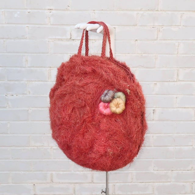 Step into summer with a fun and functional 1950's straw tote handbag. The exotic design will transport you to the tropics...