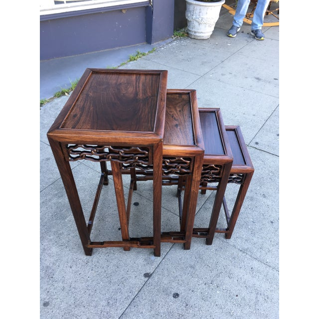 Wonderful set of Chinese hand carved nesting tables in solid Rosewood. Recently refinished to showroom condition - this is...