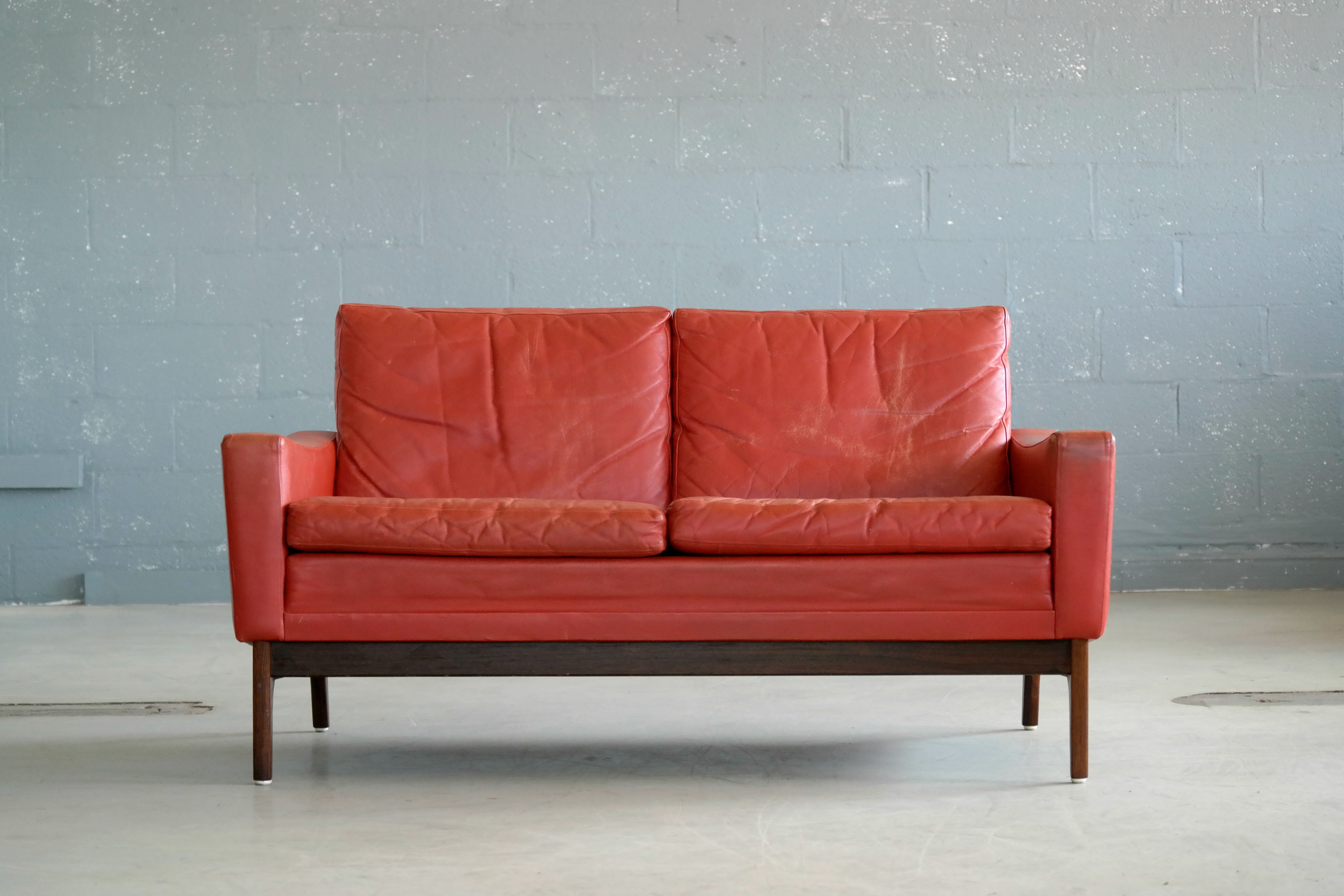 Classic Danish Mid Century Modern Sofa In Red Leather And Rosewood Base    Image 3