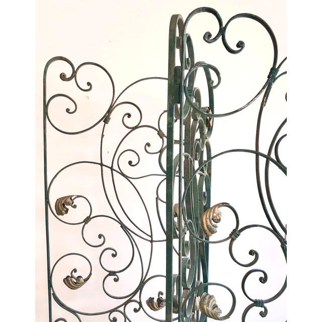 Antique heavy wrought iron screen divider gate in green with gold leaves through out.