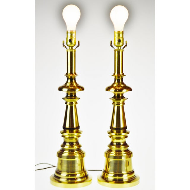 Vintage Brass Candlestick Table Lamps - A Pair Condition consistent with age and history. Patina was been maintained;...