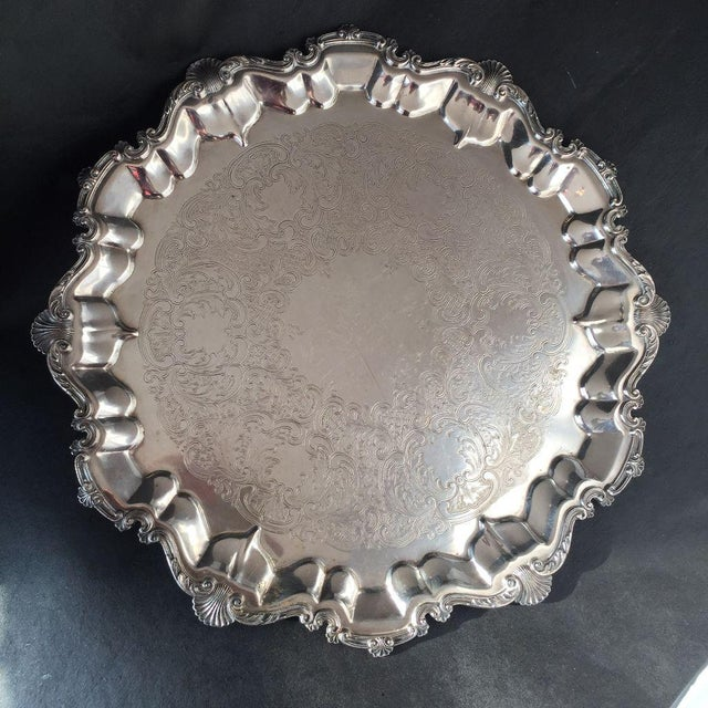 "Vintage elegant ornate silver plate tray, there is hallmark but no makers mark, in very good condition. Dimensions: 16.5""D"