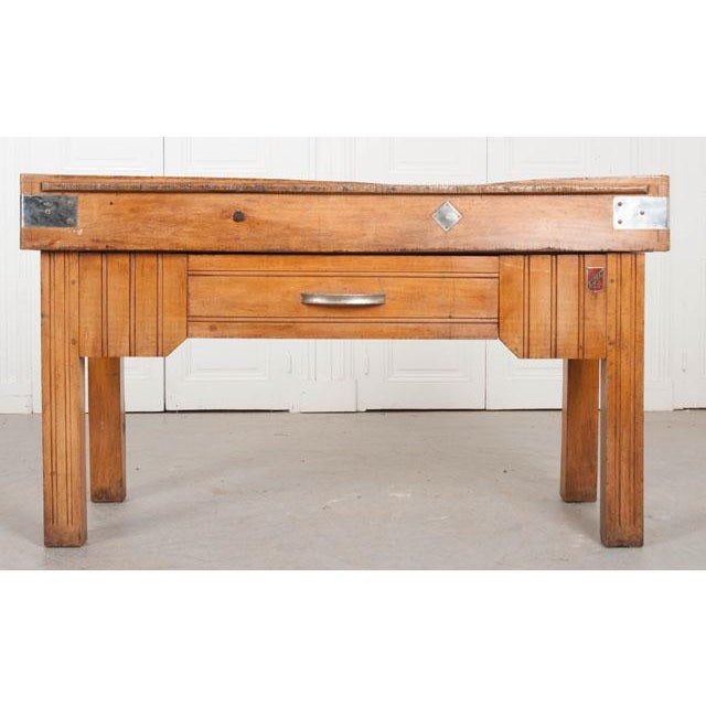 A fine butcher table, made in Nantes, France circa 1920. The table's top boasts exceptional patination. A groove has been...