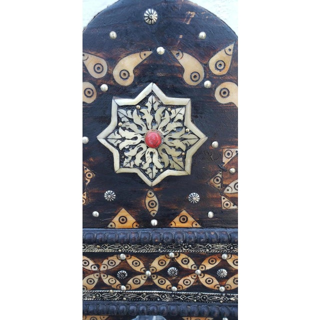 Large size metal inlay Moroccan mirror. Made in the city of Marrakech. Rectangular shape with an arched top, measuring...