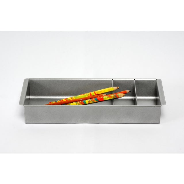 Once the insert to a classic tanker desk's utility drawer, we repurposed this neat Industrial piece for use as a desktop...