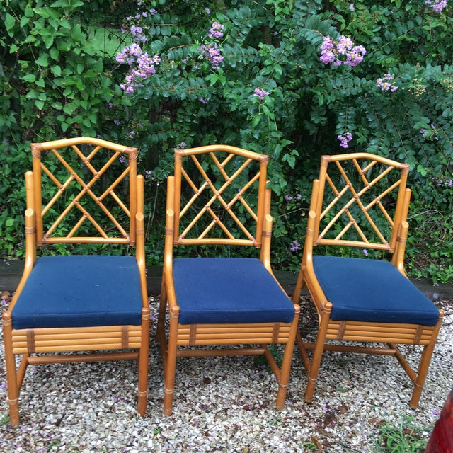 These are adorable bamboo style/ rattan Chippendale side chairs. These chairs are in excellent condition and feature a...