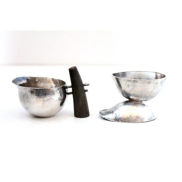 """1950s sculptural and asymmetrical silver and bone creamer and sugar bowl signed Susan Hunt. Creamer dimensions: H: 2.5"""",..."""