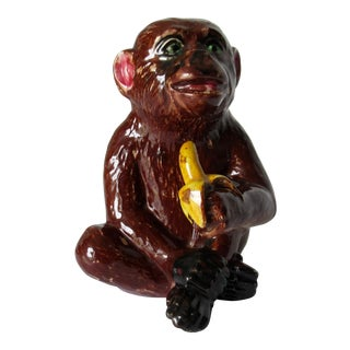Porcelain Ceramic Glazed Majolica Sitting Monkey With Banana For Sale
