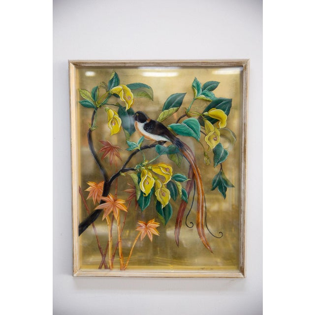 Vintage set of beautiful framed two layers of glass reverse painted birds in tropical scene with gold leaf backing.