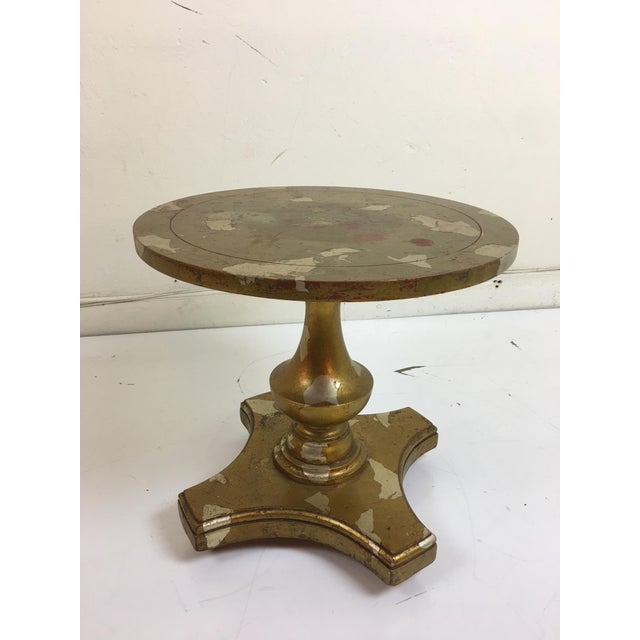 James Mont round side table in distressed gold leaf poly-chrome finish (rare in it's original condition).