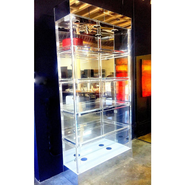A rare vintage Lucite étagerés in The Style Of Charles Hollis Jones. This Massive MID - CENTURY Lucite MODERN CURIO...