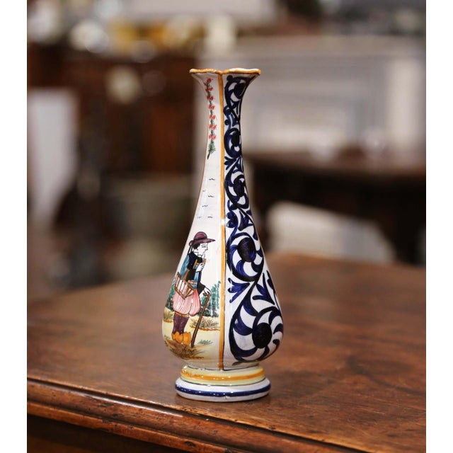 Decorate a shelf with this colorful hand painted flower vase. Created in Brittany, France, circa 1950, the small ceramic...