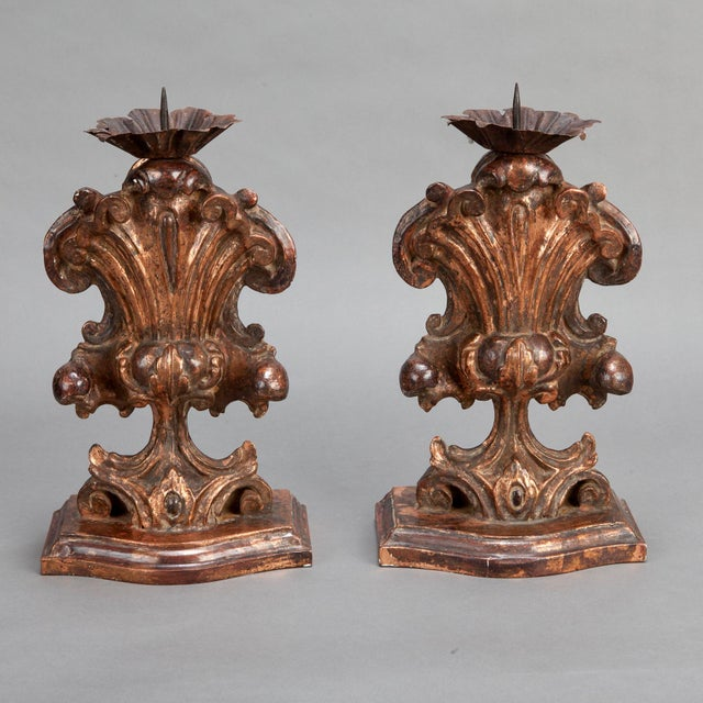 Circa 1900 pair of tall Italian hand-carved wood candle holder amphoras in a copper or dark bronze metallic gilded finish....