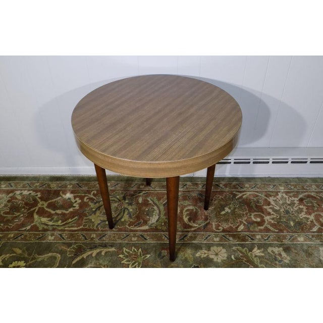 This listing is for a vintage side table by Thonet, New York. Simple, classic design and a practical size. This is direct...