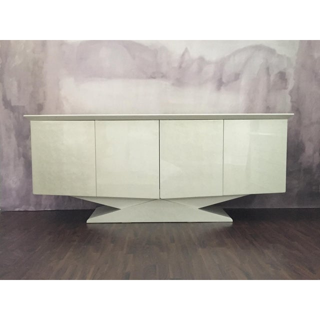 Contemporary monumental lacquered finish credenza. Perhaps early 1990's or late 1980s. Glossy white pearlescent color with...