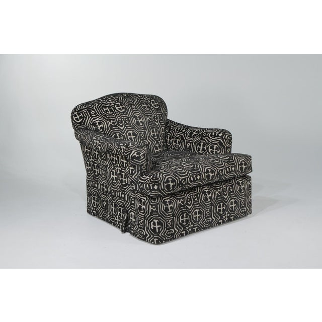 Luxe swivel club chair on casters with matching ottoman upholstered in chic graphic black and white cut velvet. Measures:...