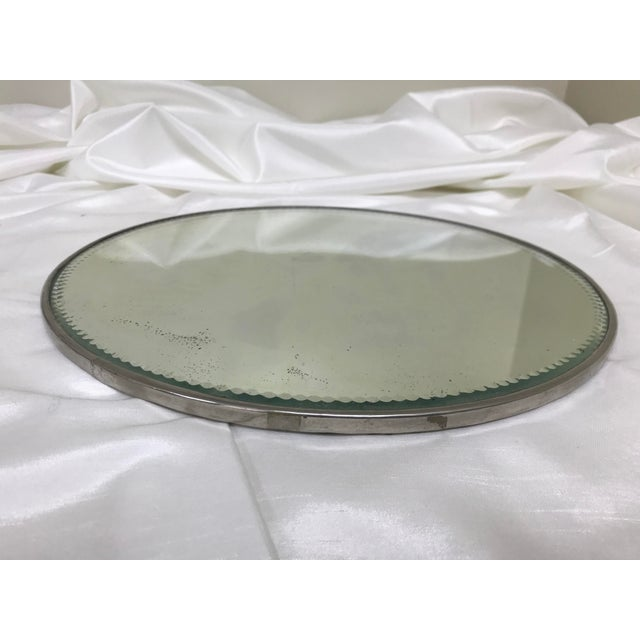 Handsome antique large plateau mirror with a classic silverplate edge with scalloped cut detail on glass. An excellent...