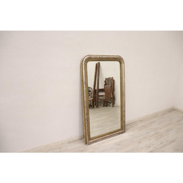 Large antique wooden mirror 1850s with refined decoration in gold and silver. small defects at the base see all the...