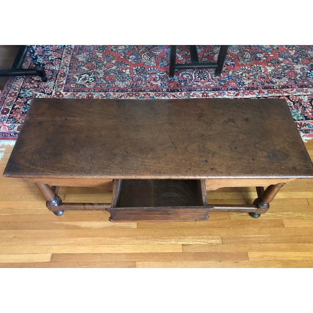 Antique French Henry II style low boy walnut coffee table.This item was most probably the base to a cabinet in the late...