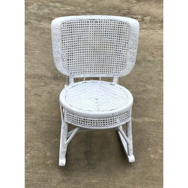 Nice white wicker rocking chair with a new coat of paint. Perfect shabby chic style.