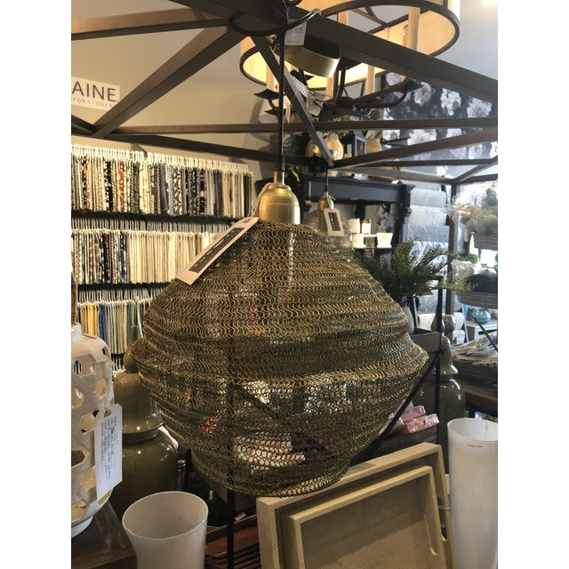 This fantastic copper mesh pendant is organic yet modern. The mesh is expandable to fit your design space. Outfitted with...