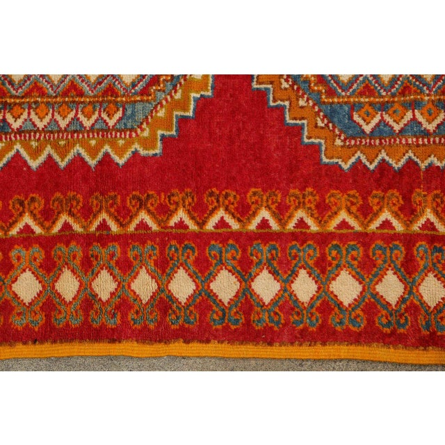 Vintage Berber rug from the Taznakht tribe in south eastern Morocco. Rare piece with beautiful color combination in...