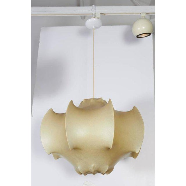 An icon of italian lighting and a unique process to produce. Several layers of resin are sprayed on a wire frame to create...