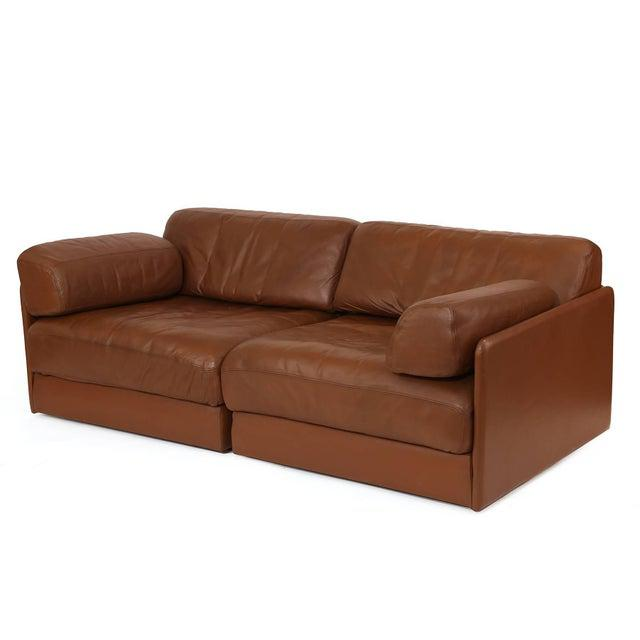 De Sede leather chairs or sofa, circa mid-1970s. These examples are done in their original supple milk chocolate leather...