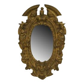 American Victorian style (1st qtr 20th Cent) gilt bronze oval wall mirror frame with cupid heads and figures on side with broken pediment top (E.F. CA