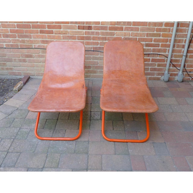 Fabulous pair of leather lounge chairs on metal frames. These low riders are the ultimate seat for relaxing. The leather...