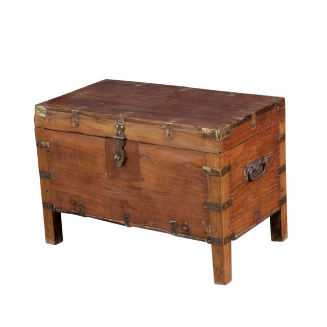 This wooden campaign box is the perfect storage piece as it stands on square legs and is accented with decorative brass...