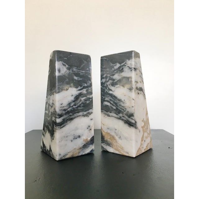 Pair of vintage modern solid marble bookends in black, gray and tan.