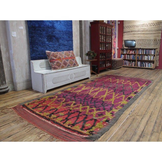 A fascinating Moroccan Berber carpet, attributed to the Ait Bou Ichaouen tribes. Working within the traditions of her...