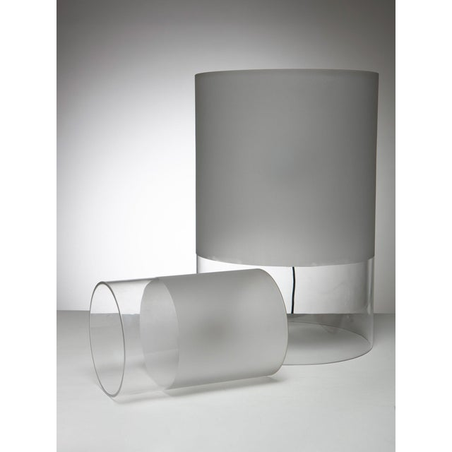 """Set of two """"Fatua"""" table lamps by Guido Rosati for Fontana Arte. Totally composed by a glass cylinder with sandy part to..."""