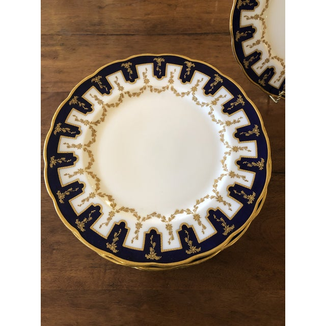 Incredibly regal set of 12 Ovington Brothers porcelain dinner plates having heavy gold relief and cobalt blue design with...