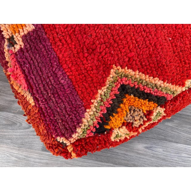 Unique Vintage Moroccan Floor Pillow hand-woven by Artist Berber craftswomen from vintage Moroccan boujaad rugs that have...