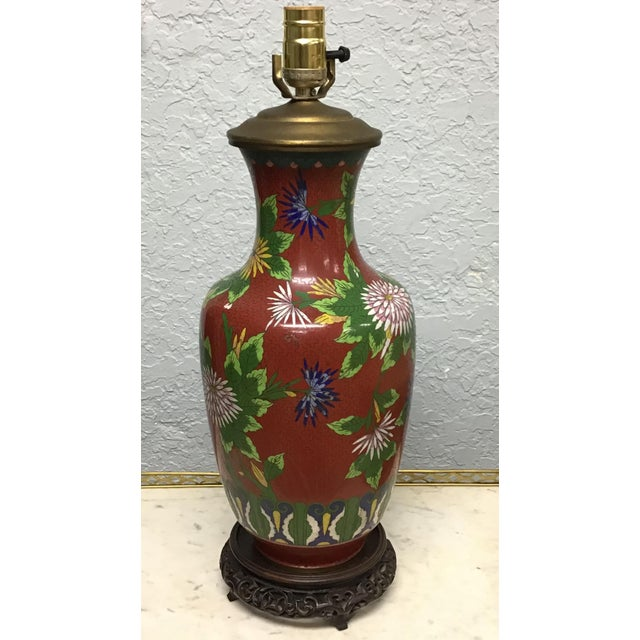 Finely detailed Cloisonné Lamp. Vivid combination of intense colors and design. It was made in the mid 20th century. The...