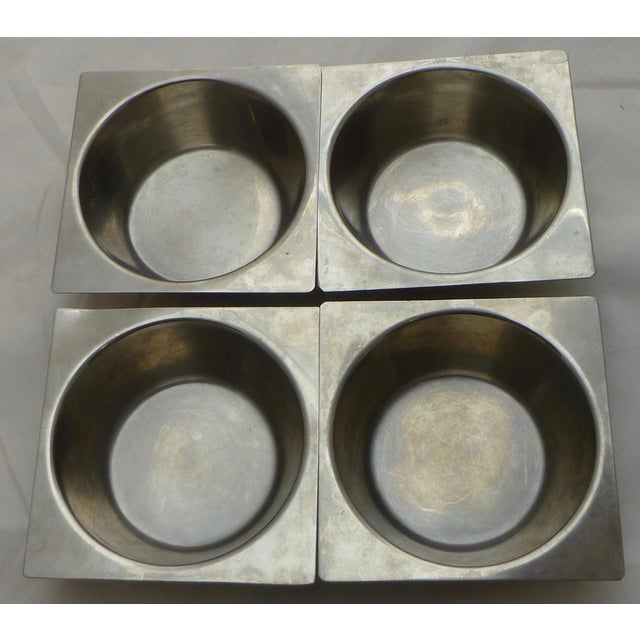Set of four Danish modern stainless steel bowls, by Vermillion of Sweden. Some light scratches throughout the pieces....