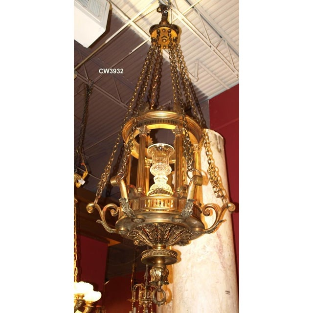Very fine gilt bronze and crystal chandelier with the internal form of a lantern. The lantern itself is 43 inches long,...