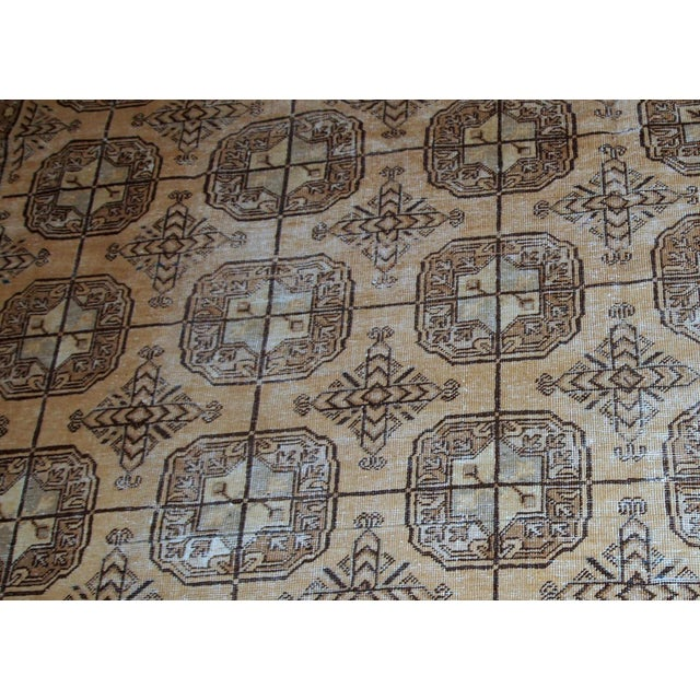 Handmade antique East Turkestan distressed rug with repeating pattern. It is in brown shade, made in the beginning of 20th...