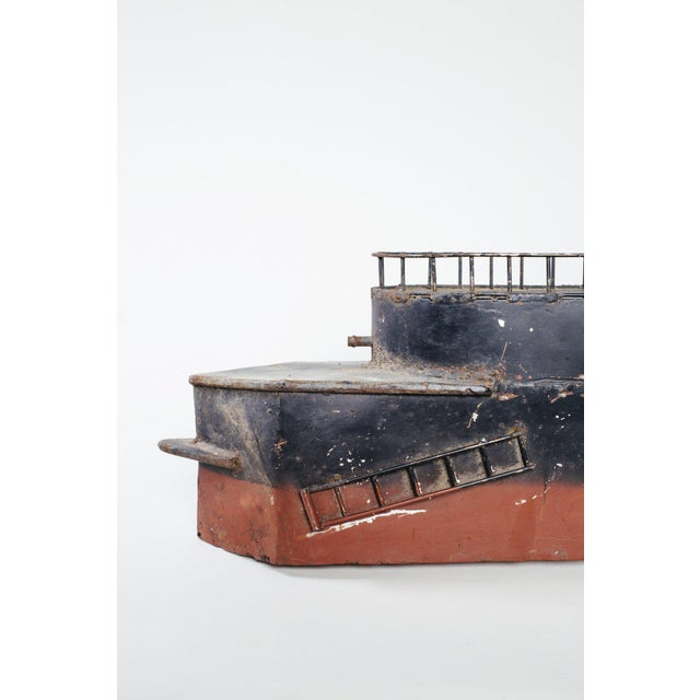 """Vintage metal steamboat painted red and black with detailed upper deck railing. Length: 30 1/2"""" height to upper deck: 8""""..."""