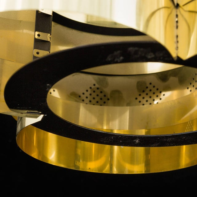 "Polished brass pendant by Verner Schou for Coronell Elektro Denmark. Measurements height: 7.1 in. (18 cm), diameter: 16""..."