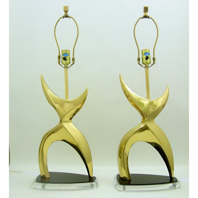 Extraordinary pair of vintage brass abstract sculptural lamps in the style of Phillipe Jean with black and clear Lucite...