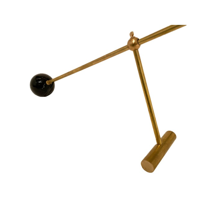 Stilnovo style vintage desk lamps from Italy. This pair is made of brass and lacquered steel in the manner of Stilnovo....