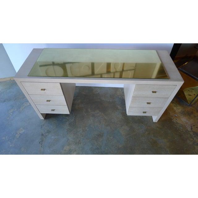 A modern, contemporary bleached oak desk. Glass top over unlacquered brass. Custom hammered brass pulls. See all photos...